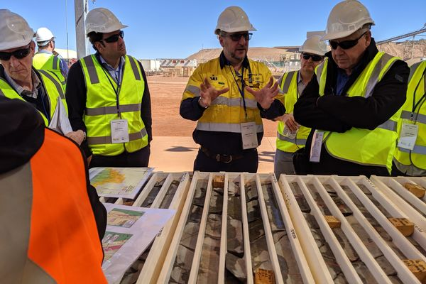 old oad executive director ustin sborne showing visitors core from ruyere during a site visit