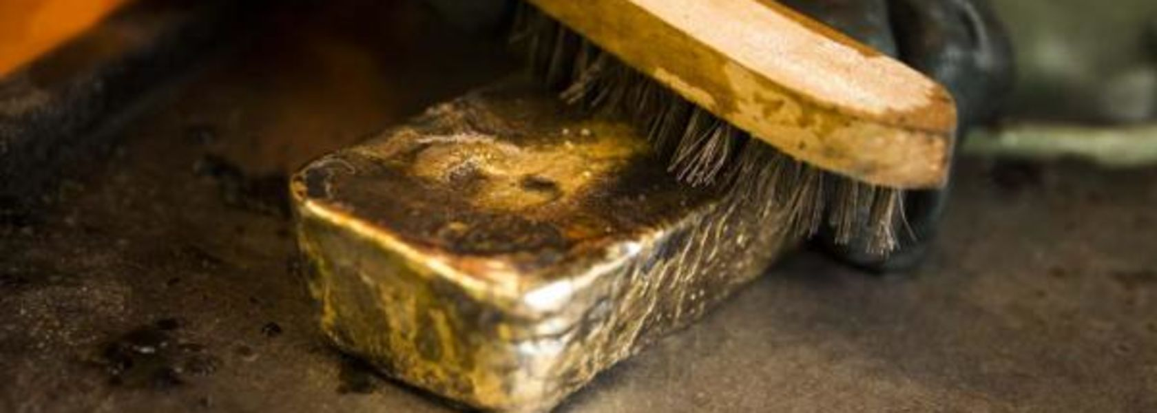 AngloGold lowers costs, debt