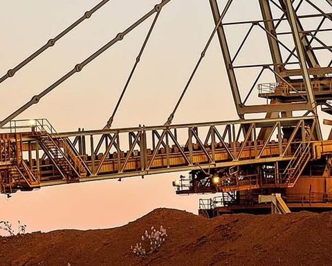 BHP claims iron ore cost crown