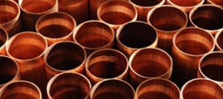 S&P lifts copper, iron ore forecasts