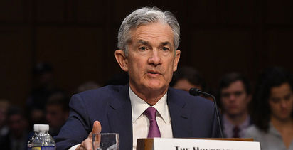 Dovish Fed signals pause in rate rises